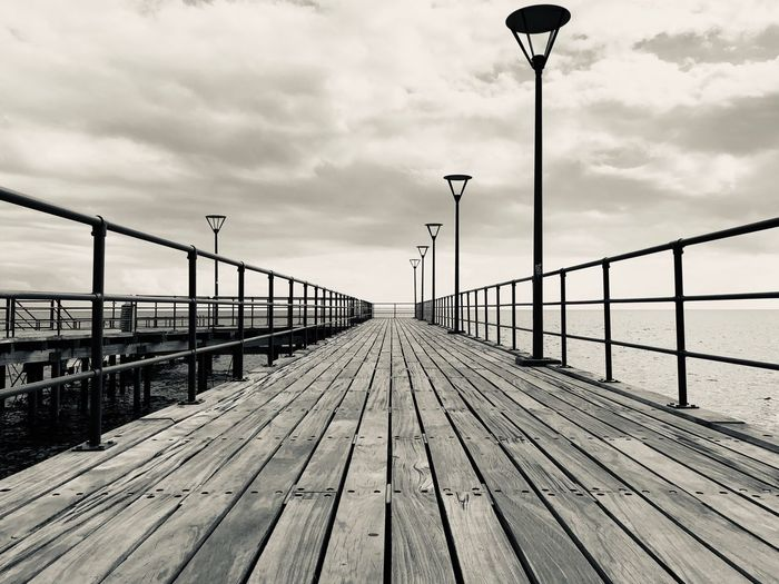 Lights Wooden Wharf Clouds White And Black Art Beauty Pier Sky Cloud - Sky Street Street Light Bridge Nature Railing Day Lighting Equipment Built Structure Bridge - Man Made Structure Direction Architecture The Way Forward Connection No People Water Diminishing Perspective Sea Outdoors