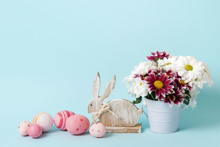 Various flowers on table against white background