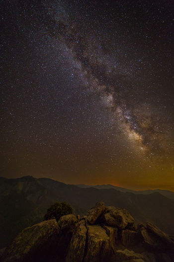 What else does one really need? | The night at Moro Rock in Sequoia National Park was quite beautiful. The light pollution from Visalia was rather intense. The distinctive Castle Rocks and Paradise Peak sat across the Middle Fork from Moro Rock, and beyond their ridgeline, Homers Nose and Maggie Mountain in the far distance appeared under the rising Milky Way. As always, gazing at our own galaxy was a humbling experience, which made the solitude more profound. I literally kept this giant granite slab to myself. Not a single soul was around as I was lying there and counting the stars while thinking about where I had been, where I was and where I was headed in life… What else does one really need? Sequoia National Park, CA Adventure Astronomy Astrophotography Beauty In Nature Castle Rock Forest Galaxy Landscape Photography Milky Way Mountain Mountain Range Mountains Nature Night Night Photography No People Outdoors Paradise Peak Sequoia National Park Sierra Nevada Sky Space Star - Space Stars Tranquility