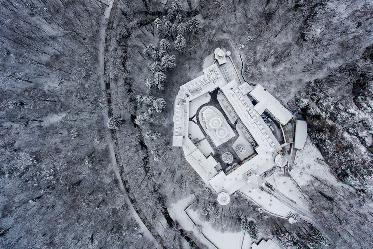 Directly above shot of built structure in forest during winter