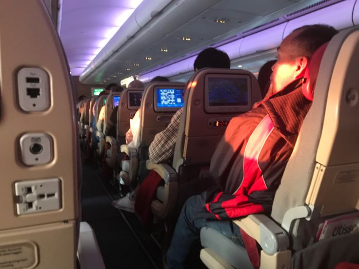 Vehicle Interior Transportation Mode Of Transport Airplane Sitting Illuminated Airplane Seat Vehicle Seat Cockpit Men Real People Indoors  Commercial Airplane Day Adult People