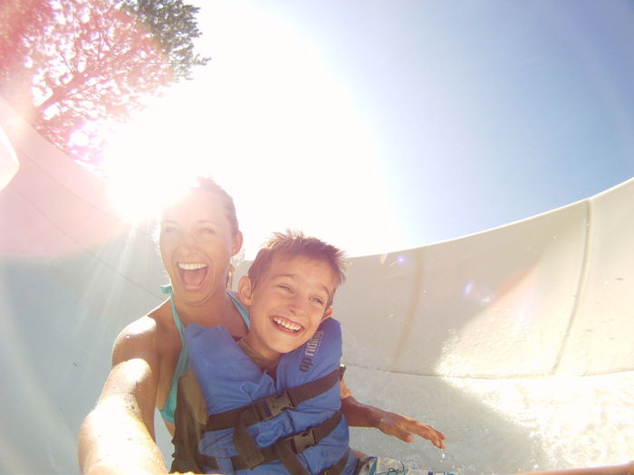 Woman and boy on waterslide