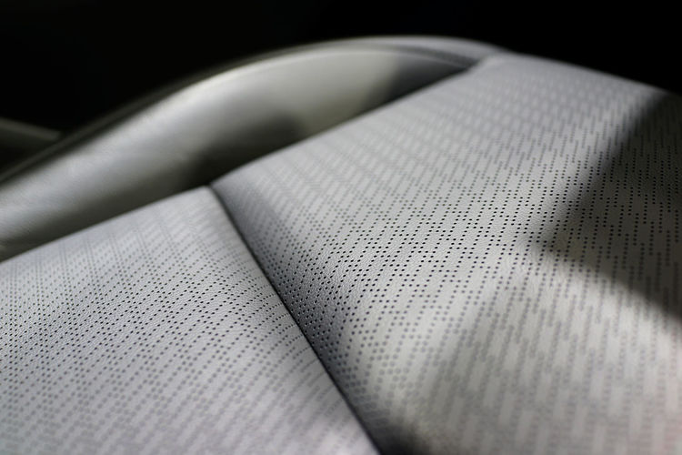 Close up part of leather car seat background Close-up Selective Focus Indoors  Textile Still Life No People Pattern Textured  Material Technology Backgrounds Gray Detail Full Frame Car Interior Luxury Leather Modern Skin Smooth Tannery Vehicle Comfortable Texture Soft Industry Furnishing Craftwork Comfort Automobile Assembling Seat