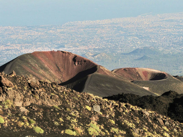 Two small cones in the southern flank of volcano Etna; Catania in the background Catania City Cones Craters Etna Geology Italy Landmark Landscape Mountain Nature Outdoors Scenics Sicily Summit Tourism Unesco UNESCO World Heritage Site Vegetation View Volcano