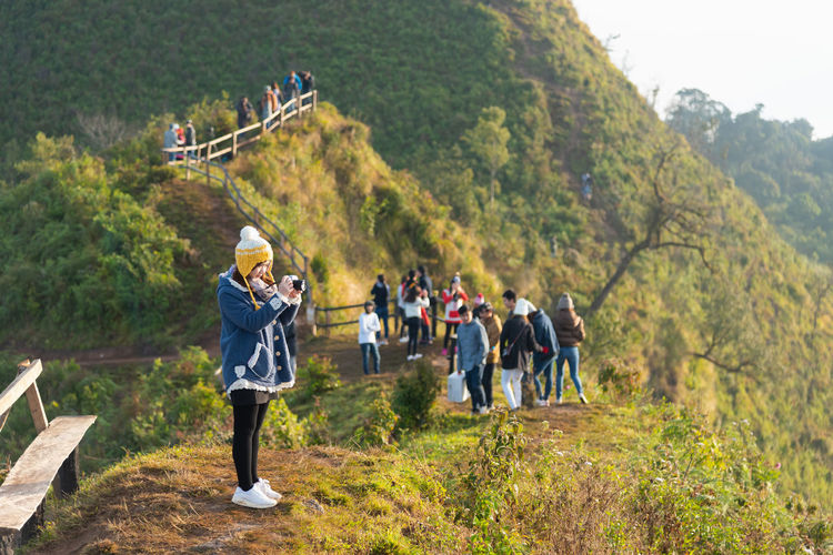 12 December 2016, Tourist travel at Phu chee daw mountain at chiang rai. Thailand Activity Adult Adventure ASIA Background Backpack Beautiful Blue Forest Grass Green Group Happy Hike Hiker Hiking Hill Landscape Leisure Lifestyle Man Mountain Natural Nature Outdoor Outdoors Park People person Rock Scenic Sky Sport Summer Tourism Tourist Travel Tree Trekking Vacation View Woman Young