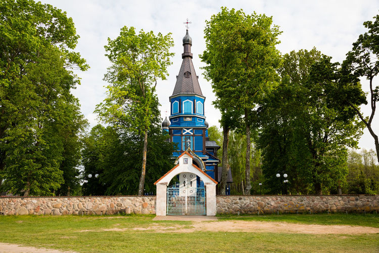 Low Angle View Of Church Amidst Trees