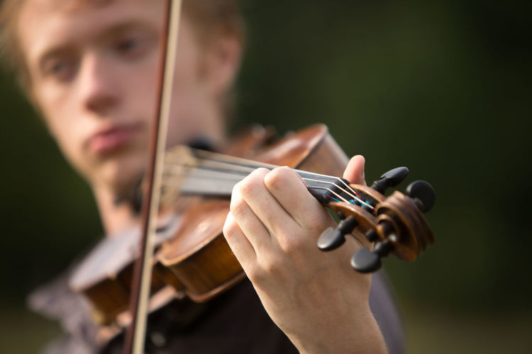 Close-up of man playing violin
