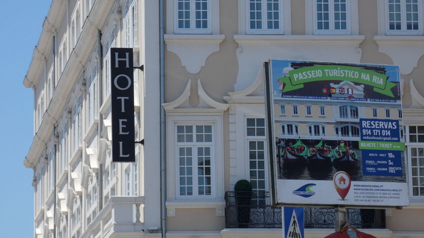 Hotel from Aveiro. 10 Perspective Adult Architecture Building Building Exterior Buildings Built Structure City Communication Day Hotel Human Representation Lifestyles Low Angle View Men Outdoors People Real People Sign Structure Text Western Script Window Women