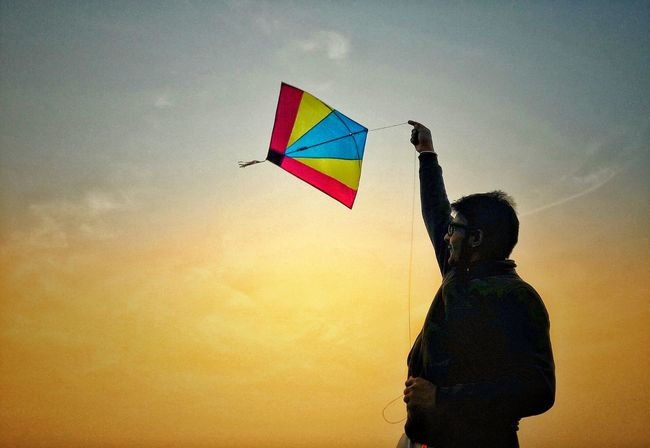 india EyeEmNewHere Multi Colored Flying Fun One Person Sky People Rear View Holding Kite - Toy Silhouette Rainbow Children Only Happiness Carefree Leisure Activity Child Human Body Part Childhood Standing Cheerful Visual Creativity