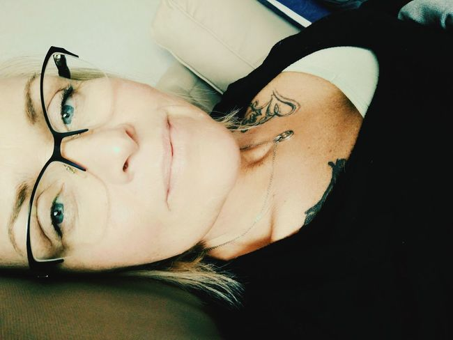 F***ing fever One Person Lying Down 57days Sobriety  Fighter Worrier Nevergivingup Eyeglasses  Front View Close-up Looking At Camera Portrait That's Me Stillfocus Relaxation Feelingblue One Woman Only Tattoo Real People Indoors  Home
