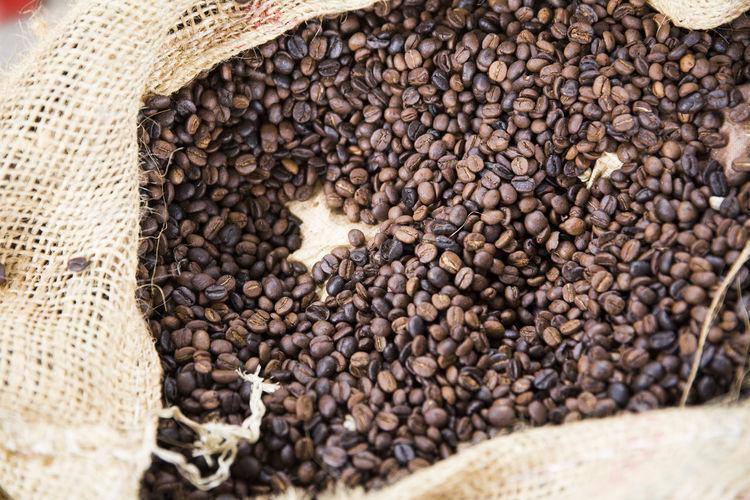 Full frame shot of roasted coffee beans in burlap