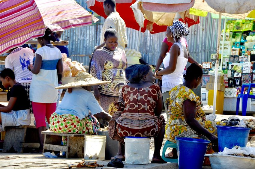 Faces Of Africa Ghana Market Market Scene Market Vendor Sitting Tradition Traditional Culture Traditional Clothing Woman Woman Power Africa Developing Country Large Group Of People Market Place Outdoors Real People Selling Selling On The Street Togetherness Women