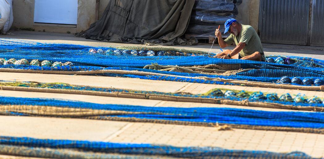 Man working on blue floor