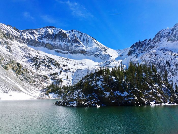 Mountain Beauty In Nature Scenics Nature Snow Mountain Range Tranquil Scene Cold Temperature Tranquility Winter Sky Landscape No People Outdoors Snowcapped Mountain Day Water Blue Lost In The Landscape
