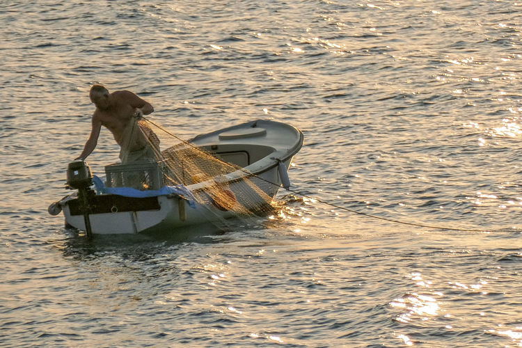 Transportation Mode Of Transportation Nautical Vessel Sea Motion Water One Person Day Nature Waterfront Outdoors Men High Angle View Travel Sailing Sinking Occupation Rippled