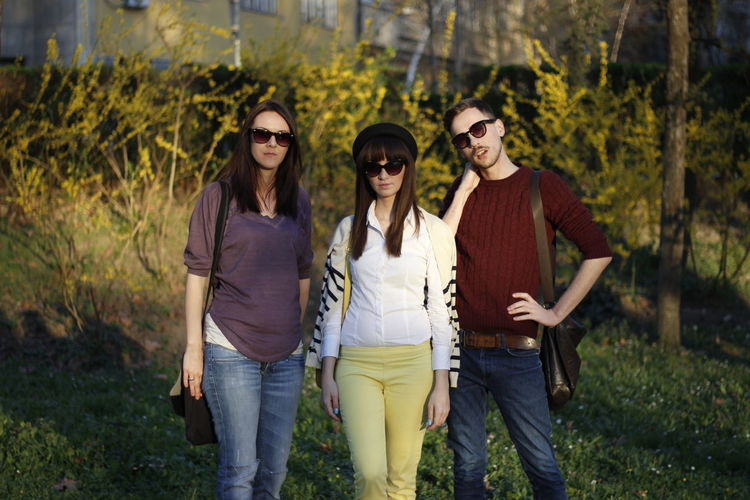 Full length portrait of young friends