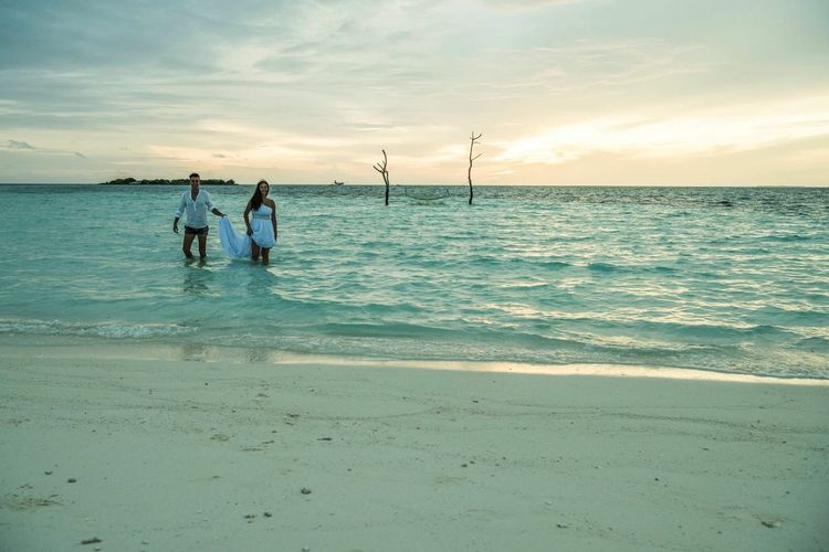 Wedding in Maldives Sea Beach Water Nature Horizon Over Water Sky Beauty In Nature Sand Real People Scenics Sunset Cloud - Sky Tranquil Scene Men Leisure Activity Outdoors Tranquility Standing Vacations Lifestyles Wedding Wedding Photography Wedding Photorapher Maldives Maldivesphotography