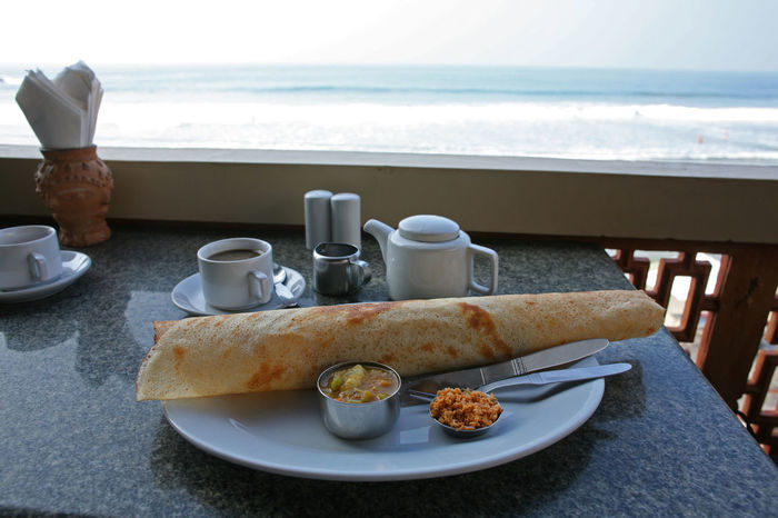 Curry India Kovalam Kovalam Beach Masala Dosa Thiruvananthapuram Bread Breakfast Coffee - Drink Coffee Cup Drink Food Food And Drink Freshness Healthy Eating Outdoors Plate Sea Table Travel Destinations Trivandrum Water