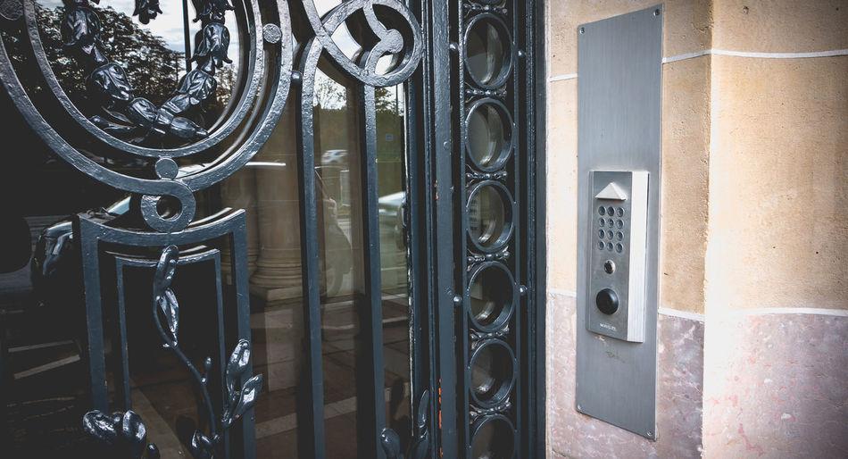 Close-up of metal door of building