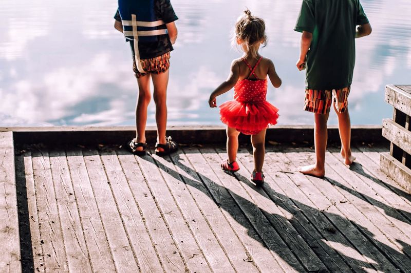 River. Girls Walking Childhood Outdoors Togetherness Low Section Real People Rear View Day Leisure Activity Family Child Full Length Standing Human Body Part Sky Water Nature People Adult