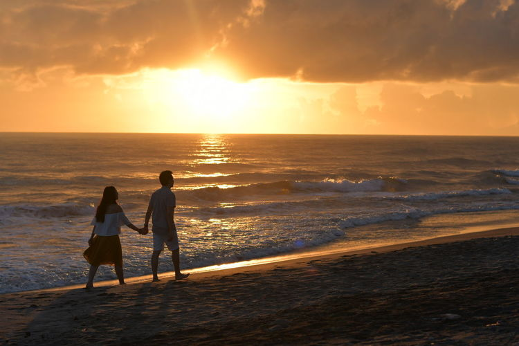 Sea Beach Sunset Two People Vacations Togetherness Full Length Horizon Over Water Sand Enjoyment Sun Rear View Adult Lifestyles Nature Love Nikon D500 Nikon Wedding Prenup Sunlight Women Walking Bonding Live For The Story EyeEm Selects