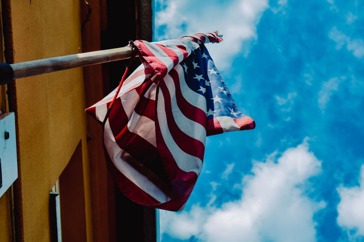 Low angle view of usa  flag against sky