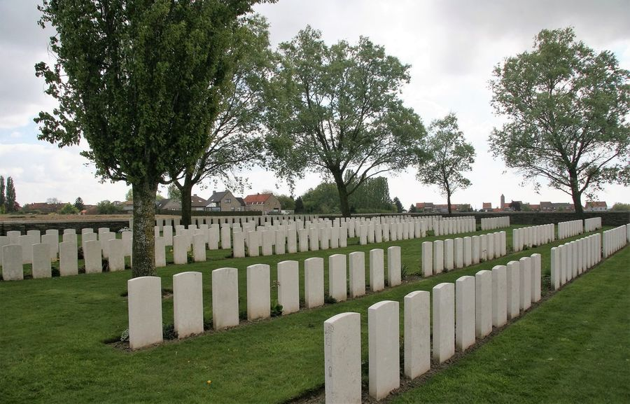 Messines Ridge British Cemetery is located 10km south of Ieper on the Nieuwkerkestraat, outside Mesen. The battle for Messines ridge began on 7th June 1917. Located inside the Messines Ridge British Cemetery is a plaque to the Maori Battalion. There's also a memorial to the New Zealand soldiers who fell in or near Messines in 1917 and 1918 and whose graves are known only to God. This is one of seven memorials to the officers and men of New Zealand who died on the Western Front without a known grave. http://pics.travelnotes.org/ Belgium British War Graves Commonwealth War Graves Horizontal Messines Ridge Michel Guntern Travel Photography Battle British Cemetery Cemetery Grass Gravestone Graveyard Green Color In A Row Landscape Memorial Military No People Remembrance Rural Scene Tombstone Travelpics Tree War