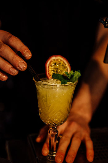 Cropped image of person holding drink