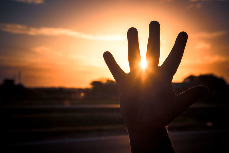 Sunset Sky One Person Human Hand Human Body Part Silhouette Hand Real People Sun Body Part Orange Color Lens Flare Unrecognizable Person Nature Human Finger Finger Focus On Foreground Sunlight Back Lit Stop Gesture Human Limb
