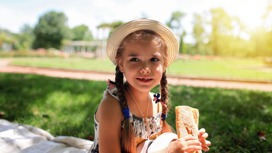 Portrait of girl holding ice cream