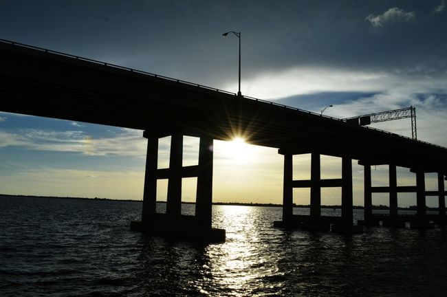 Burning Bridges Cloud - Sky Sunset Built Structure Silhouette Sea Bridge - Man Made Structure Outdoors Sky Water Architecture Tranquility No People Day Horizon Over Water Nature Tonights View City Silhouette Lee County, Florida