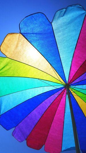"""""""Under my umber-ella-ella-ella ay ay ay"""" -Rihanna 😆 Rainbow Umbrella Blue Sky Umbrella The Beach  Sun Umbrella Rainbow"""