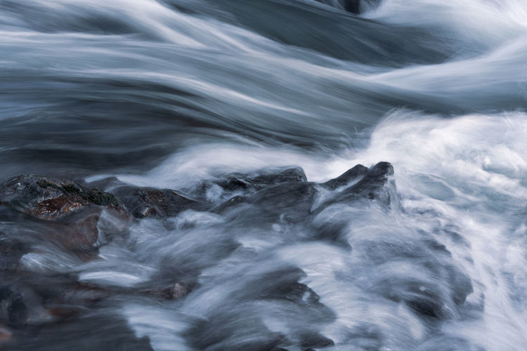 Motion Water No People Scenics - Nature Rock Beauty In Nature Solid Blurred Motion Long Exposure Rock - Object Nature Sea Day Non-urban Scene Tranquility Outdoors Environment Full Frame Backgrounds Flowing Water Flowing Power In Nature