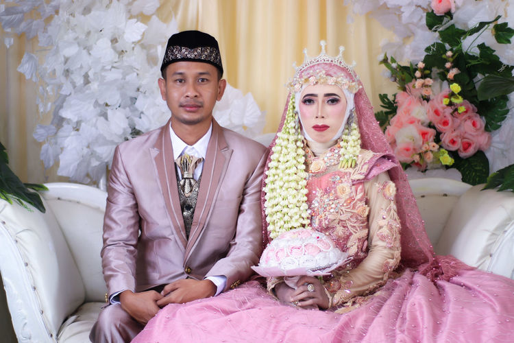 Portrait of young couple during wedding ceremony