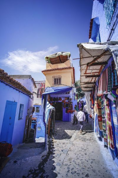 """The Blue City"" - Chefchaouen, Morocco. Chefchaouen Chefchaouen Medina Medina Morocco MoroccoTrip EyeEmNewHere a new beginning Digital Nomad Travel Travel Destinations Traveling Travel Photography Photography Blue City Alley Maze Arabic Moroccans Tourism Tourist Attraction  Tourist Destination Architecture Building Exterior Built Structure Building Sky Incidental People Day Nature Real People Street Residential District House Market Men People Outdoors Cloud - Sky The Way Forward Market Stall Street Market"