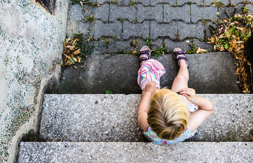 Blond Hair Child Day Full Length High Angle View Looking Down One Person Outdoors Pavement People Perspective Sitting Sitting Outside Stairs Streetphotography Summer Fresh On Market 2017