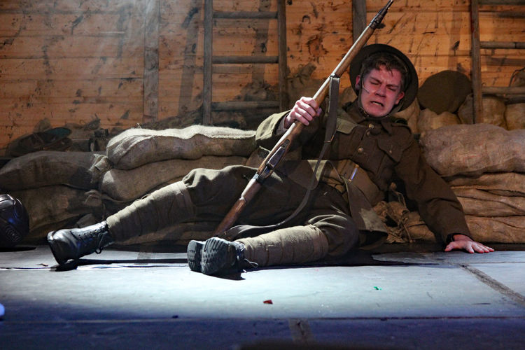 Wounded soldier Ww1 Weapon One Person Gun Young Adult Army Soldier Lying Down Warm Clothing Remembrance Soldier Trench 1914-1918