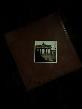 Capture Berlin City Old Times Brandenburg Gate Brandenburger Tor Berlin History Childhood Memories Old Photo Day Table No People Indoors  One One Photo Black Background Photo Book