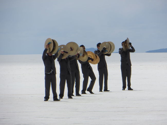 Band Capturing Motion Casual Clothing Deserts Around The World Enjoyment Friendship Front View Full Length Group Of People Horizon Over Water Leisure Activity Mask - Disguise Music Brings Us Together Musician The Color Of Business People And Places Person Playing Drums Standing TakeoverContrast Togetherness Travel Destinations Uyuni Salt Flat Vacations Dramatic Angles