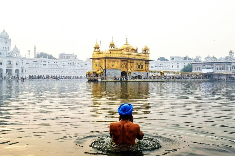 The Holy dip InMakin! Golden Temple, Amritsar Sikh Holy Pool Sikhism Sikh Temple Architecture Holy Place History Travel Destinations One Person Outdoors Breathing Space Perspective Natural Light EyeEm Best Shots My Unique Style Colourful Reflection Rear View People Randomness Building Exterior Built Structure The Week On EyeEm Paint The Town Yellow Lost In The Landscape Second Acts EyeEm Ready   Love Yourself Colour Your Horizn This Is Masculinity Stories From The City Inner Power