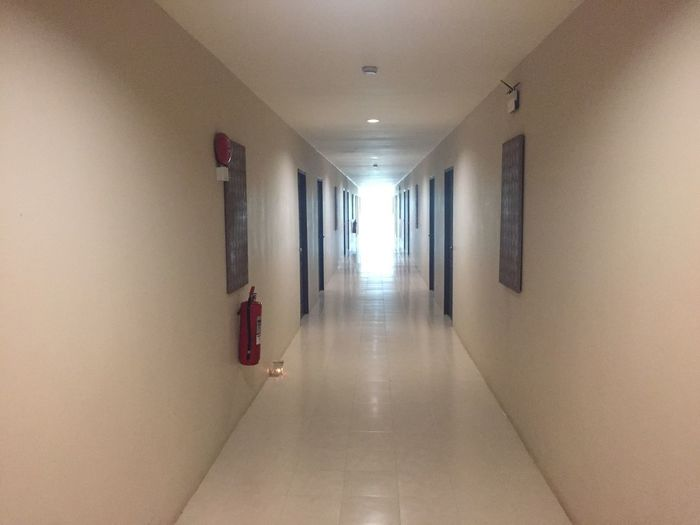 Walkway in hotel Arcade Corridor Building Architecture Indoors  Ceiling Flooring Built Structure Direction Diminishing Perspective Wall - Building Feature No People Illuminated Absence Lighting Equipment The Way Forward Entrance Emergency Equipment Door vanishing point