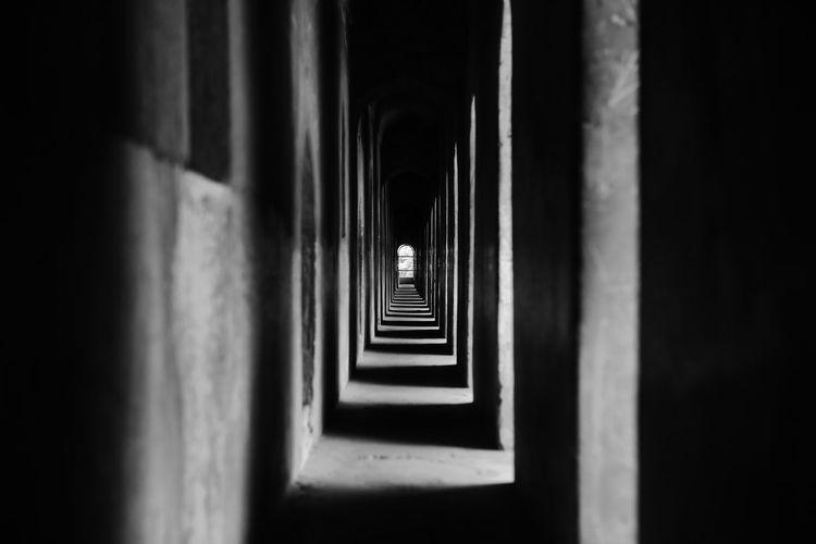 Empty narrow corridor of building
