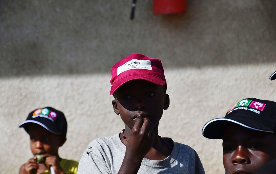 Kyamuhunga Uganda Boys Headwear Headshot Sports Helmet Teenager Altruism Friend Social Responsibility Volunteer Non-profit Organization Humanitarian Aid Inner Power