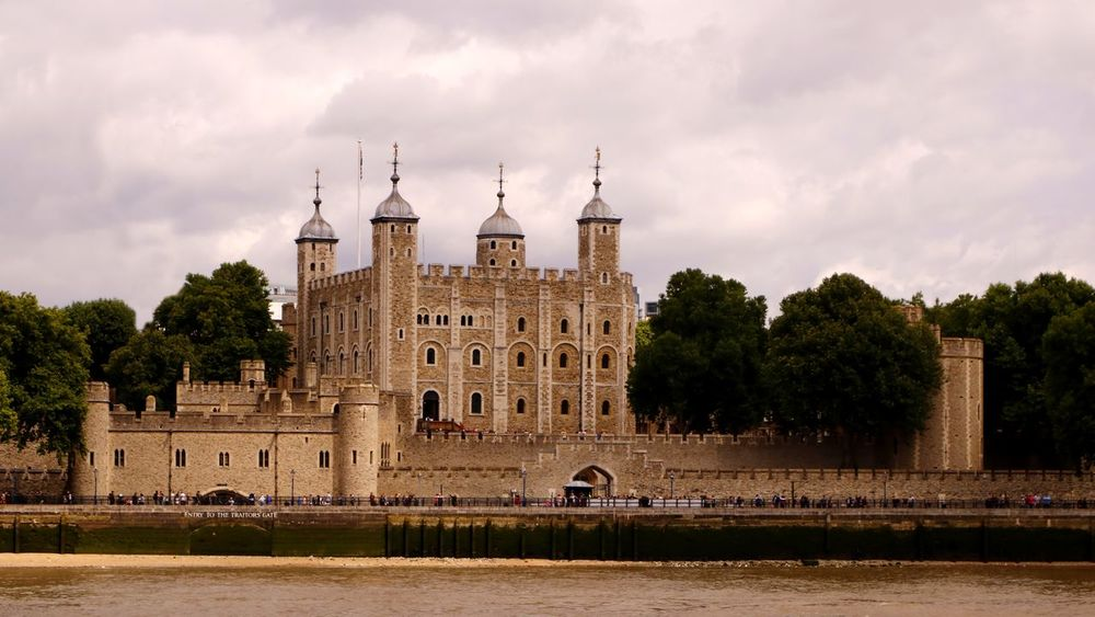 The beauty of historical workmanship of the Tower of London, England, UK as seen across the river Thames. Founded in 1066 the White Tower was built by William the Conqueror in 1078. Castle Historical Building Historical Sights Tourist Attraction  Tower Of London Travel Photography Architecture Building Exterior Built Structure Cloud - Sky Day Defence Fortification History Landmark Nature No People Outdoors Sky Stronghold Tourist Destination Travel Destinations Tree Water Waterfront The Week On EyeEm Been There.