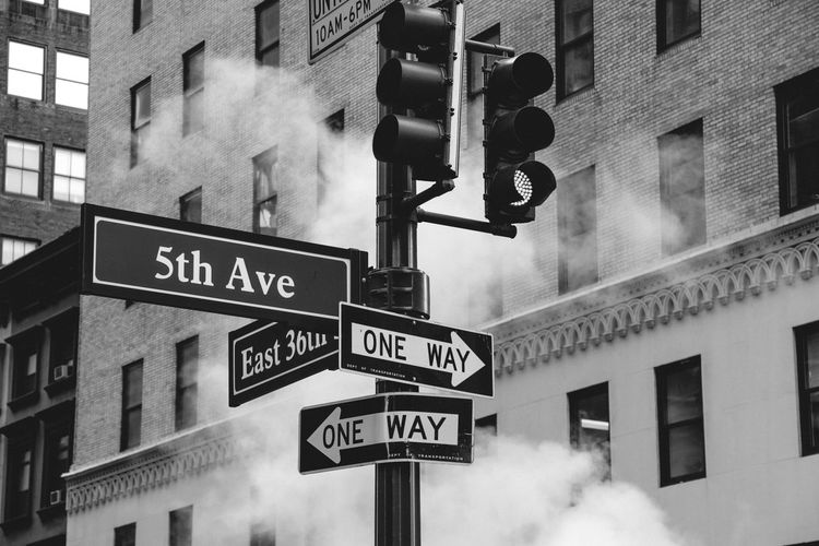 5thavenue Abstract Architecture Architecture_bw Architecture_collection Blackandwhite Building Built Structure City City Life Cloud - Sky Day Directional Sign Information Information Sign Low Angle View Modern New York No People Outdoors Pole Road Sign Sky Text Western Script