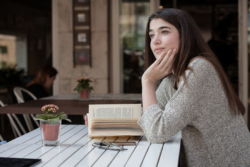 Adult Bistrot Cafe Day Drink Friendship One Person One Young Woman Only People Reading A Book Real People Selfie Smartphone Smartphonephotography Smiling Sunset Table Women Young Adult Young Women
