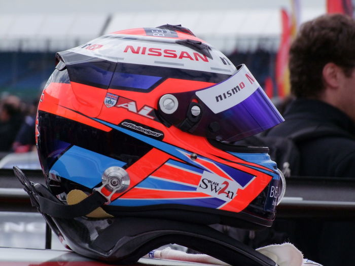 Nissan Racing Helmet & Black Swan - 2016 Blancpain GT Series - Endurance Cup Black Swan Close-up Composition First Eyeem Photo Focus On Foreground Full Frame GB Head Gear Helmet Leisure Activity Lifestyles Multi Coloured Outdoor Photography Protective Clothing Racing Silverstone Sport Uk Unusual