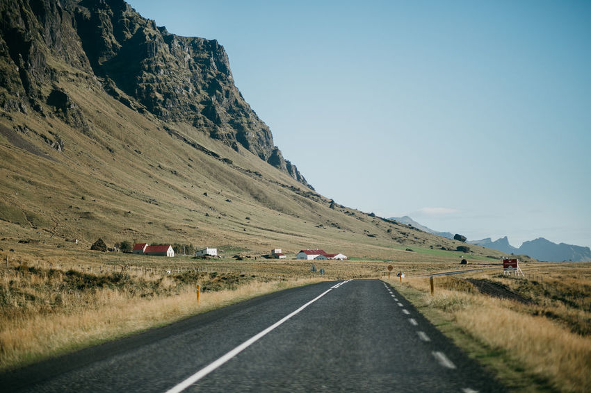 Iceland Road Beauty In Nature Clear Sky Day Grass Landscape Mountain Nature Outdoors Road Roadtrip Scenics Sky The Way Forward Transportation