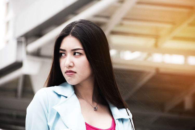 Architecture Built Structure Casual Clothing Close-up Day Focus On Foreground Front View Headshot Indoors  Lifestyles Long Hair Medium-length Hair One Person One Young Woman Only People Portrait Real People Standing Young Adult Young Women