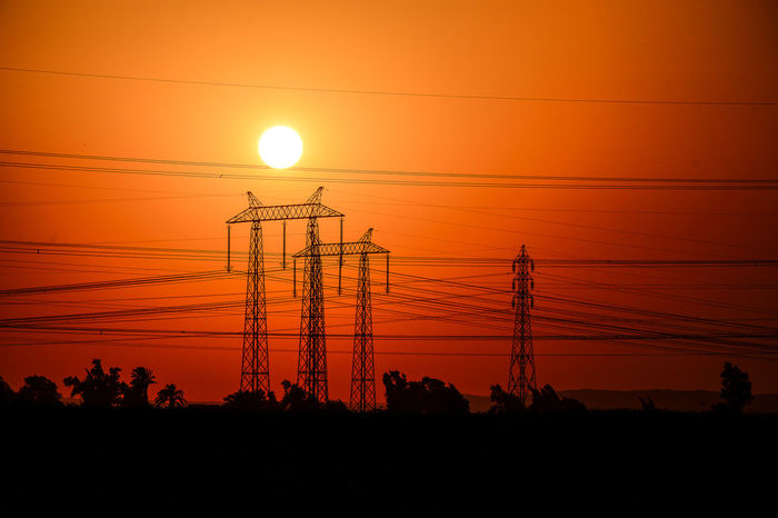 at upper egypt piwer supply from the high damAlternative Energy Beauty In Nature Cable Check This Out Dramatic Sky Electricity  Electricity Pylon Exceptional Photographs Finding New Frontiers Close Up Technology Fuel And Power Generation High Voltage Orange Color Overhead PowerLine Popular Photos Power Line  Power Supply Romantic Sky Scenics Silhouette Sun Sunlight Sunset Technology Adapted To The City Miles Away The Architect - 2017 EyeEm Awards The Photojournalist - 2017 EyeEm Awards The Great Outdoors - 2017 EyeEm Awards Gridlove